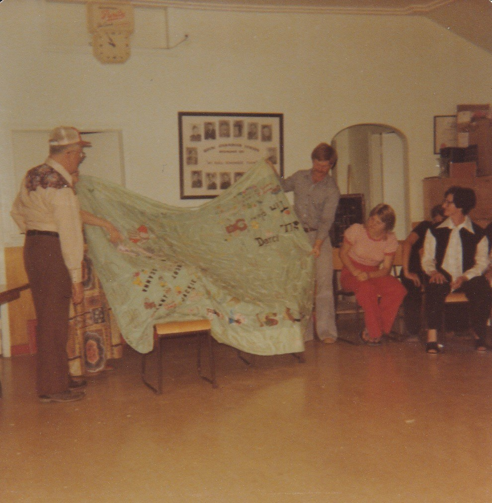 Grampa Moors receiving quilt Auntie Eleanor on far right