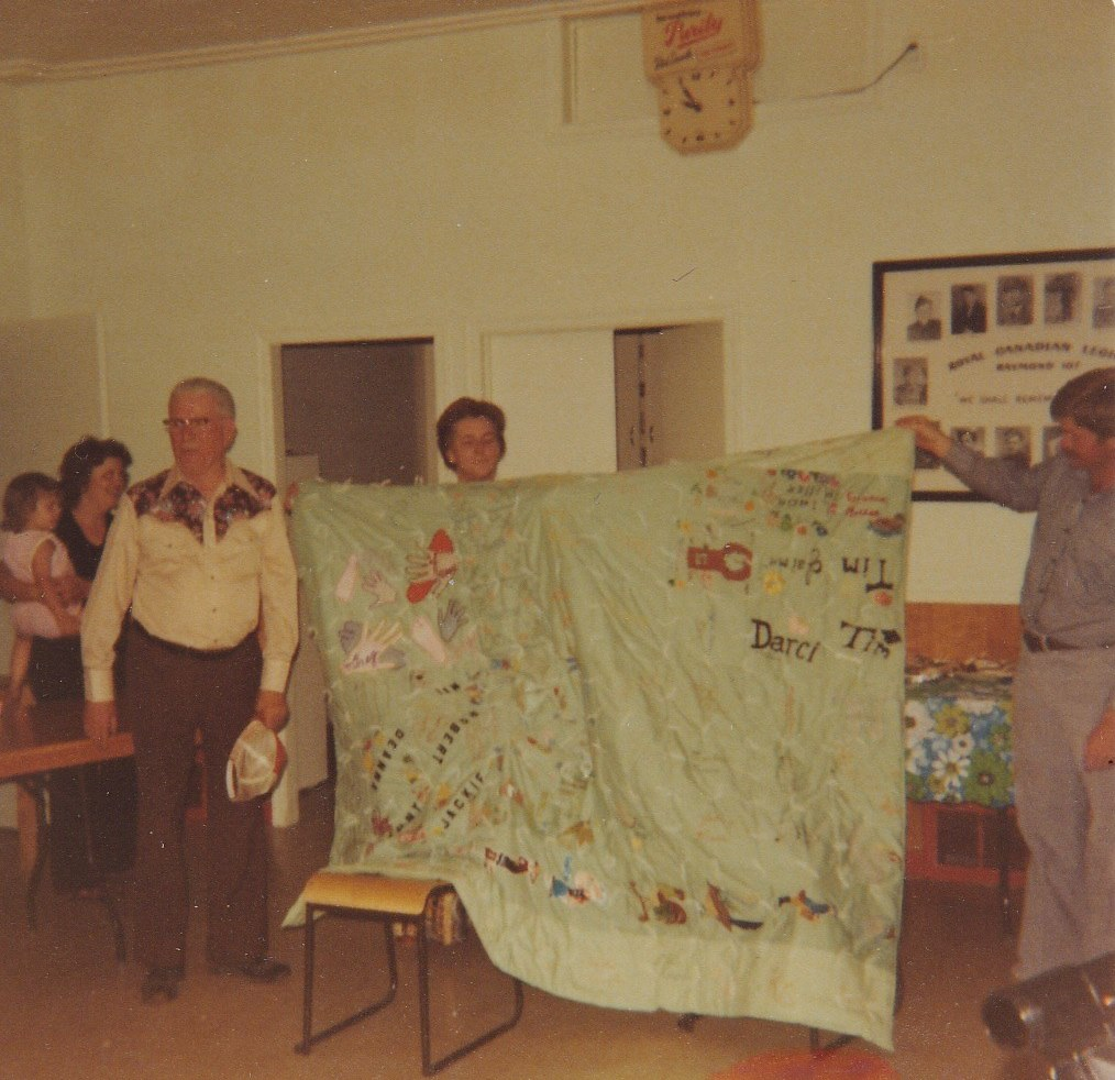 Grampa Moors with family quilt Ruth in background
