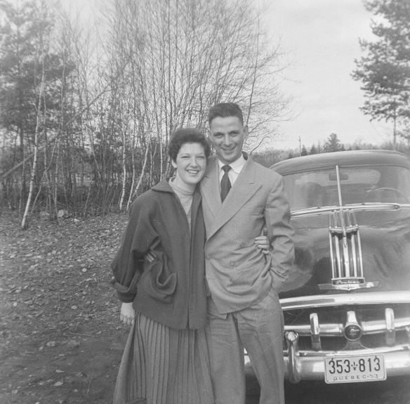 Mom and Dad and cool car from old negative